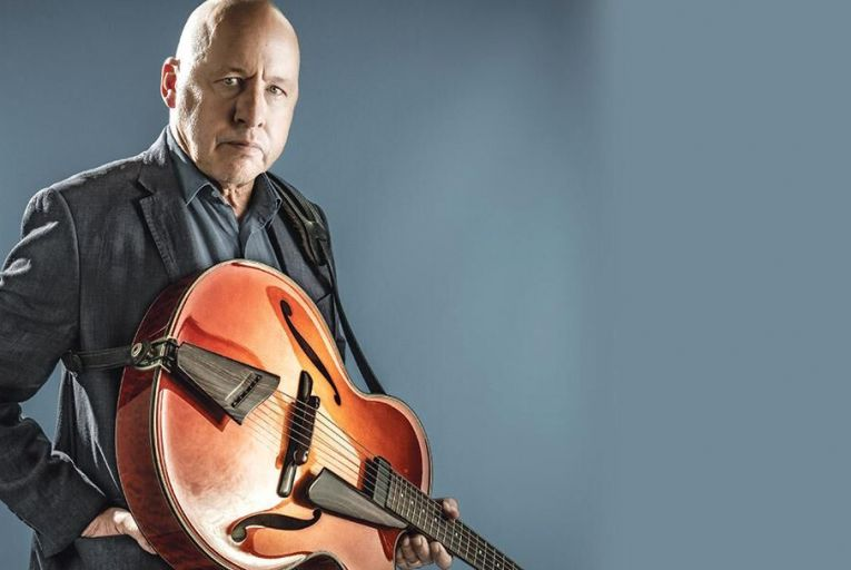 Mark Knopfler. 'I'm not very good at nostalgia . . . I don't like going back to old school reunions. I'm more interested in now' DEREK HUDSON