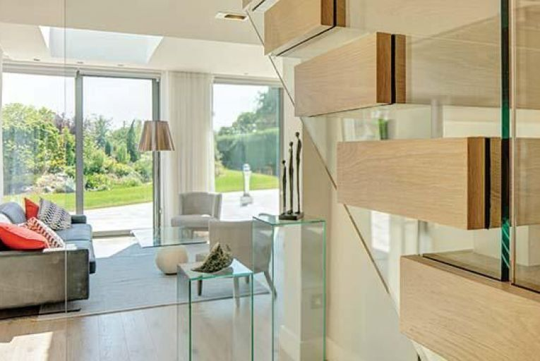 Donabate: full-height windows and doors and a floating staircase draw garden views through the house. Picture: Enda Kavanagh