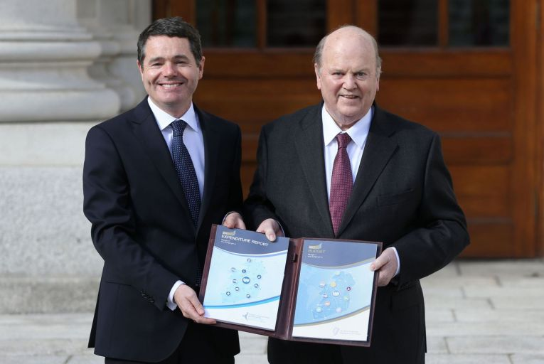 Paschal Donohoe and his predecessor as minister for finance, Michael Noonan Pic: PA