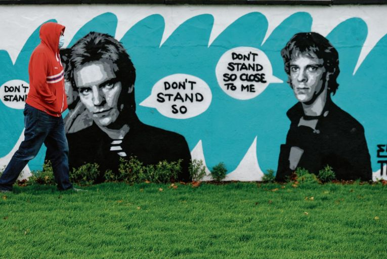 A social distancing mural in Dublin by artist Emmalene Blake featuring 1980s rockers The Police