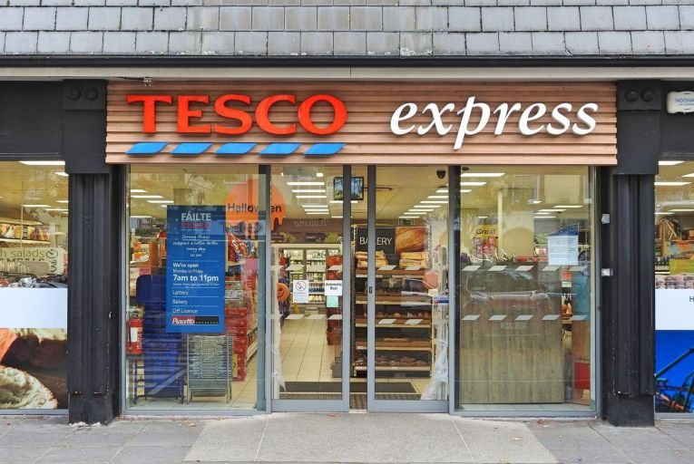 Fifty-one Tesco Express stores in Ireland have installed tablets on the self-service checkouts with cameras that film shoppers and display the footage in real time