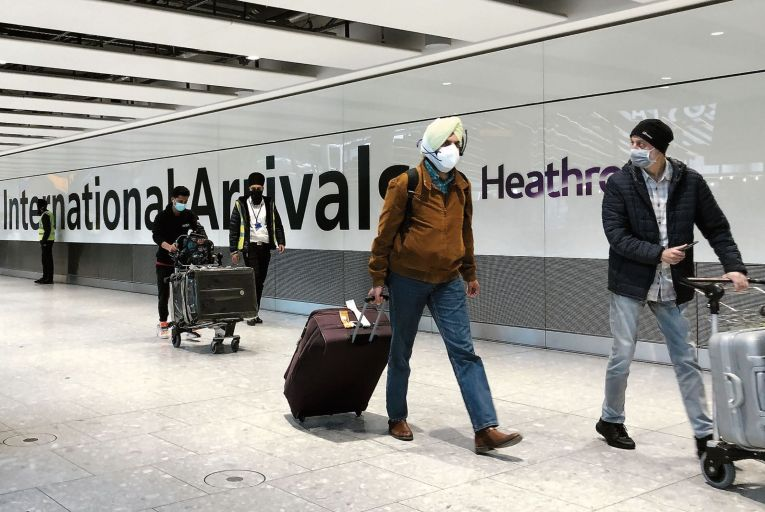 Passengers at Heathrow Airport in London walk to coaches destined for quarantine hotels: mandatory hotel quarantine for visitors arriving from India was introduced by the British government on April 23. Picture: Getty