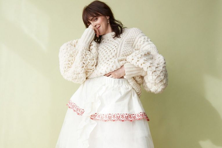 Charlene McKenna wears cream crochet sweater, €1,195, Colin Burke; cream silk and tulle embroidered skirt, €995, initial letter hoop earrings, €110 each, embroidered socks, €40, and shoes, €835, all Simone Rocha at Havana; gold plated spacer sphere ring, €35, Sorcha O'Raghallaigh; pearl ring, €249, Charlotte Lebeck at Loulerie