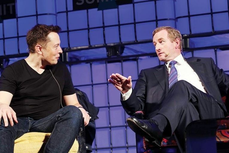 Tesla founder Elon Musk chats  with Taoiseach Enda Kenny at  the Web Summit in 2013 Picture: Conor McCabe