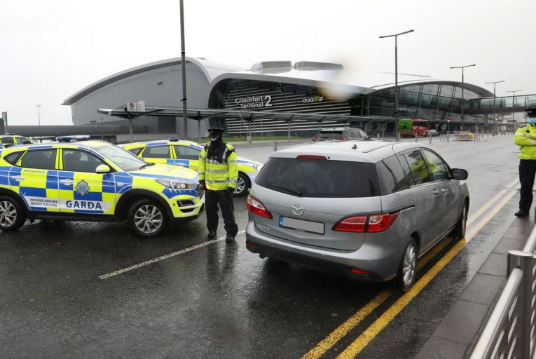 A Garda checkpoint at Dublin Airport: the Taoiseach said today that gardaí would not have the powers to check if someone who has arrived into the country is quarantining in their bedroom rather than their home. Photo: Rolling News