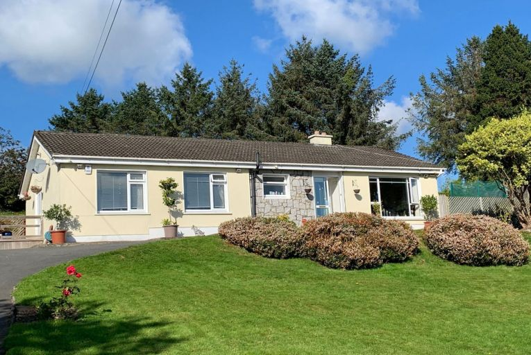 The Wicklow property comprises four bedrooms, two en-suites, a living room, fitted kitchen and a family room/office. It has an elevated rear garden with scenic countryside views
