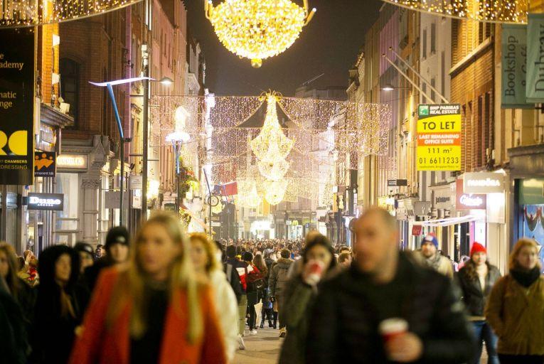Dubliners having the audacity to enjoy the Christmas lights on Grafton Street