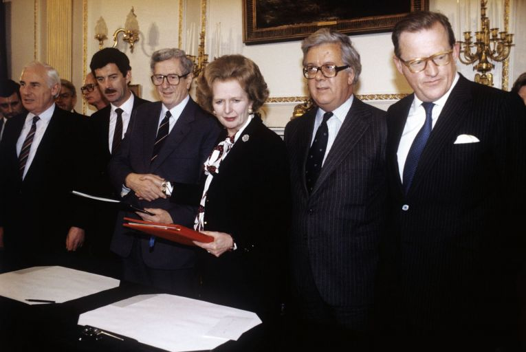 Garret Fitzgerald and Margaret Thatcher shake hands after signing the Anglo-Irish Agreement at Hillsborough in 1985. Also pictured are (from left) Peter Barry, Dick Spring, and British ministers Geoffrey Howe and Tom King. Picture: PA