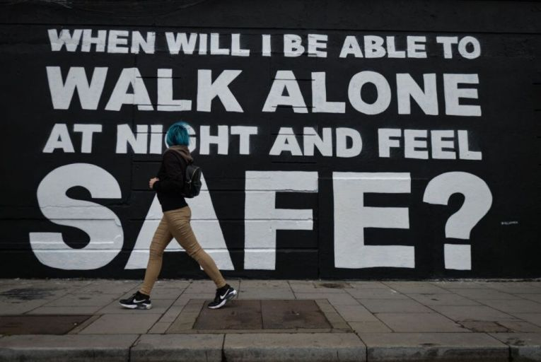 A young woman walks by a mural by Irish artist Emmalene in Dublin city centre: 'Beyond policing, we also need to look at the design of our public spaces.' Picture: Getty