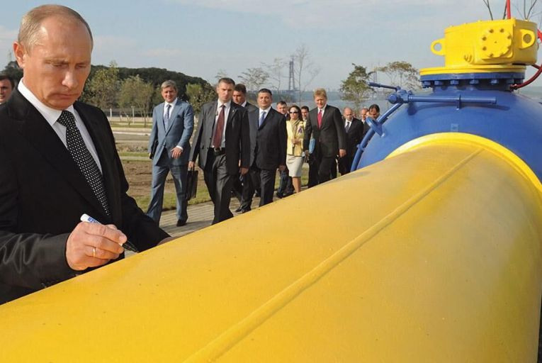 Russian president Vladimir Putin  signs an autograph on a natural  gas pipeline in Vladivostok Picture: Getty
