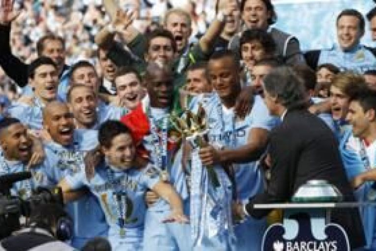 Premier League sells TV rights to Sky, BT