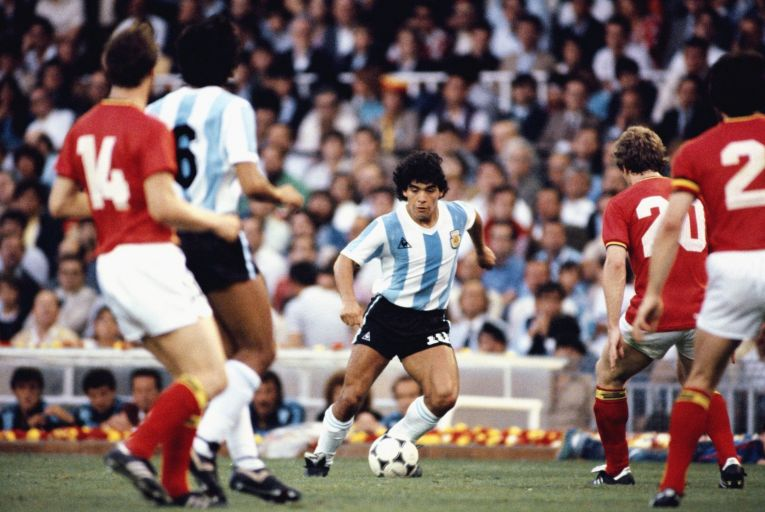 Diego Maradona, 1960-2020, takes on the Belguim defence during the 1982 World Cup. Picture: Steve Powell/Allsport/Getty Images
