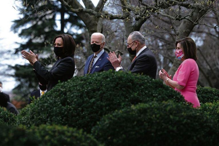 Vice President Kamala Harris, President Joe Biden, Senate Majority Leader Chuck Schumer and Speaker of the House Nancy Pelosi in the Rose Garden of the White House on March 12