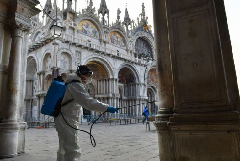 A contractor cleans public spaces near St Mark's cathedral in Venice. The Covid-19 pandemic has rapidly accelerated the use of disinfectants. Picture: AFP via Getty Images