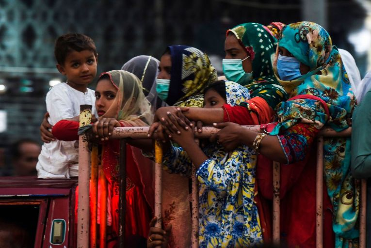 People wearing face masks in Karachi, a teeming city where criminal elements and political figures are often two sides of the same coin. Picture: Getty