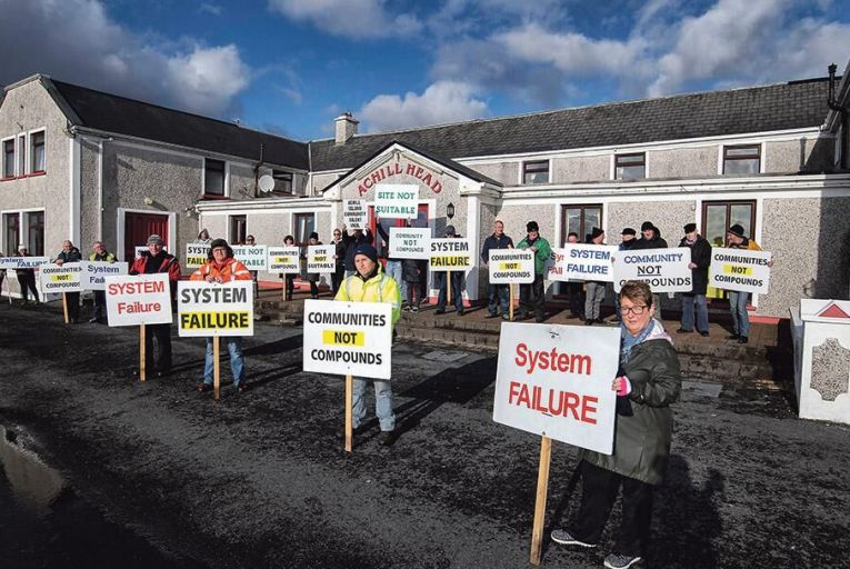 Protesters outside the Achill Head Hotel, opposing the arrival of asylum seekers in a direct provision facility inside the hotel Pictures: Michael Dillon