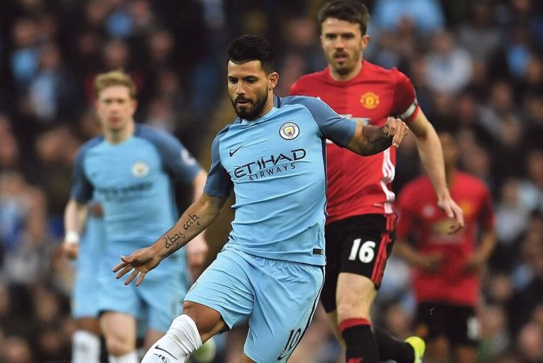 Sergio Aguero of Manchester City is closed down by Michael Carrick of Manchester United during a Premier League match at the Etihad Stadium in Manchester last AprilGetty
