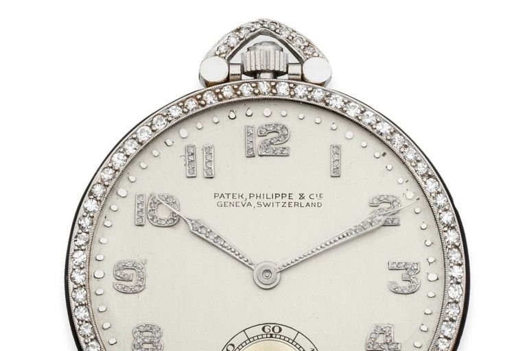 Made by Patek Philippe in 1928, it is a platinum and diamond set, keyless wind, open-face pocket watch bearing the inscription 'To my first talkie director Frank Borzage, token of admiration and sincere friendship from John McCormack, Jany. 1930\'.