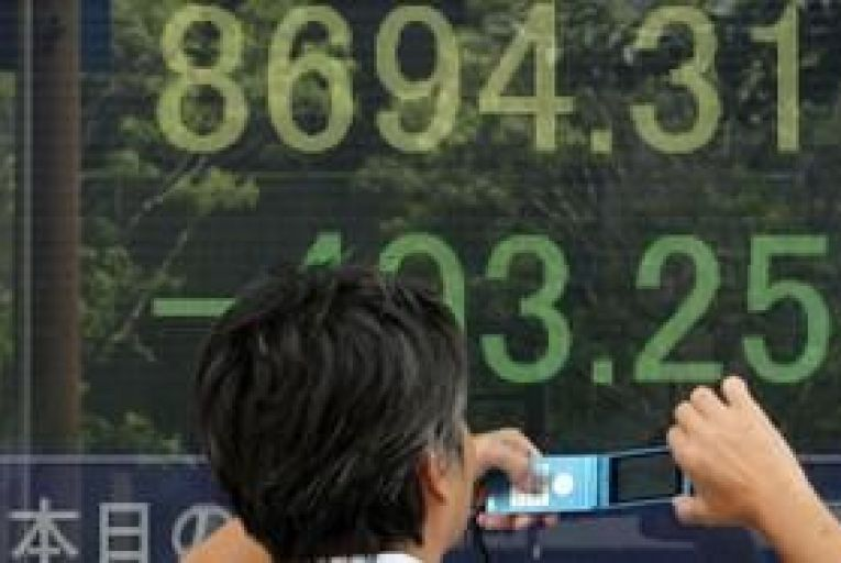 Asian shares fall on weak company results
