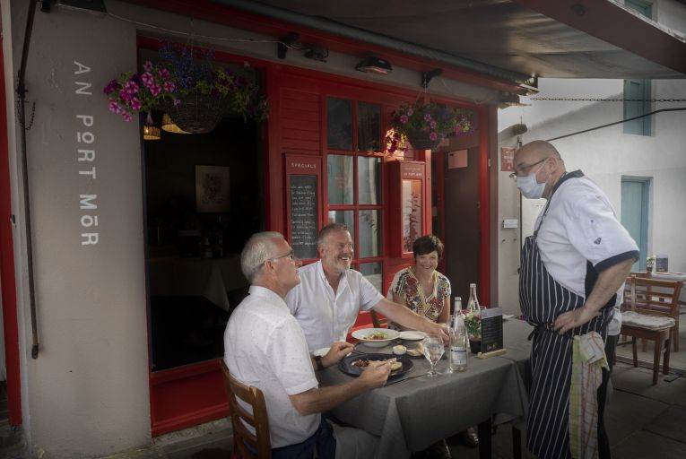 Frankie Mallon greets customers outside An Port Mór, his restaurant in Westport, Co Mayo. Picture: Michael McLaughlin