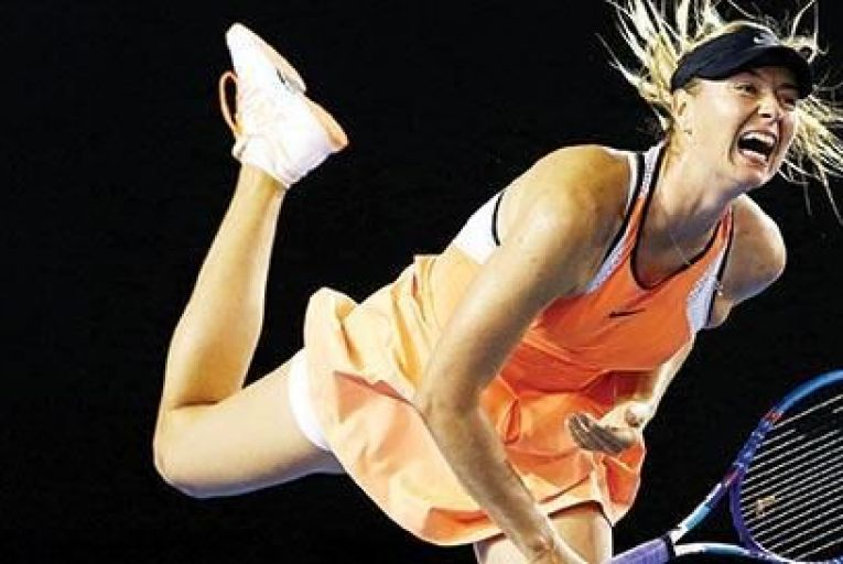 Maria Sharapova of Russia serves in her fourth round match against Belinda Bencic of Switerland during day seven of the 2016 Australian OpenGetty