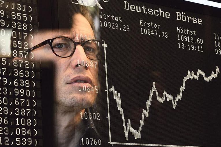 A trader watches the  ebb and flow of share  prices at the Frankfurt  Stock Exchange Picture: Getty