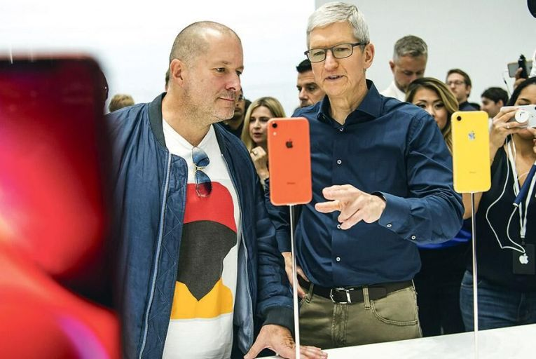 Tim Cook, chief executive, right,  and Jony Ive, chief design officer  Apple, view an iPhone XR  smartphone earlier this month Picture: Bloomberg