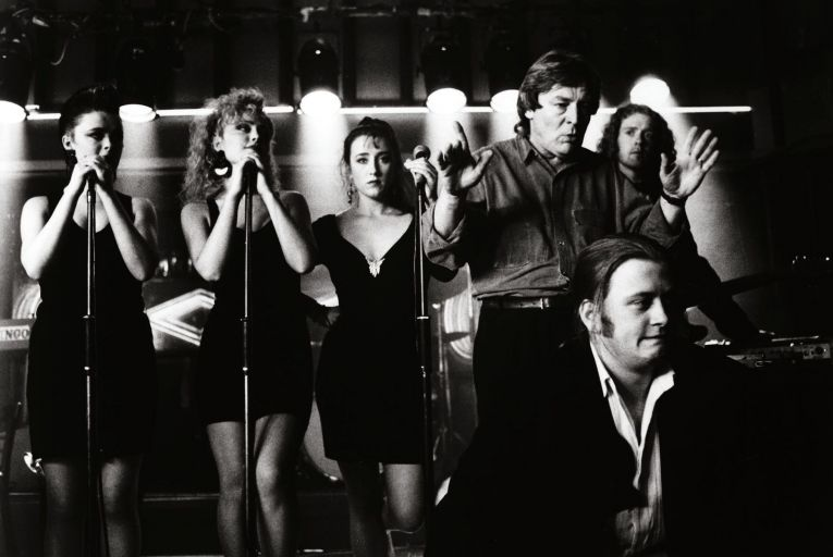 Bronagh Gallagher, Angeline Ball, Maria Doyle-Kennedy, Alan Parker, Glen Hansard and Andrew Strong on the set of The Commitments in 1991. Picture: David Appleby/Shutterstock