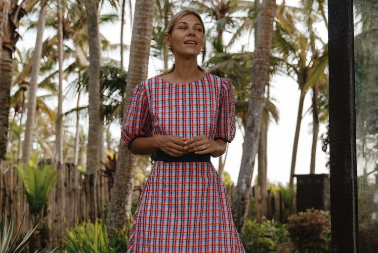Ibiza dress in gingham organza with puff sleeves and a navy covered belt, €420