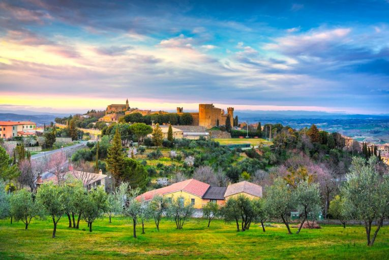 The hill of Montalcino stands out clearly among the Tuscan countryside