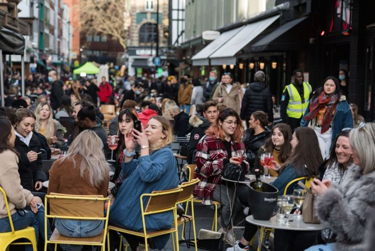 Crowds fill tables in Old Compton Street in Soho, which is closed to traffic, as outdoor hospitality venues open their premises to customers after being closed for over three months under coronavirus lockdown Pic: Getty
