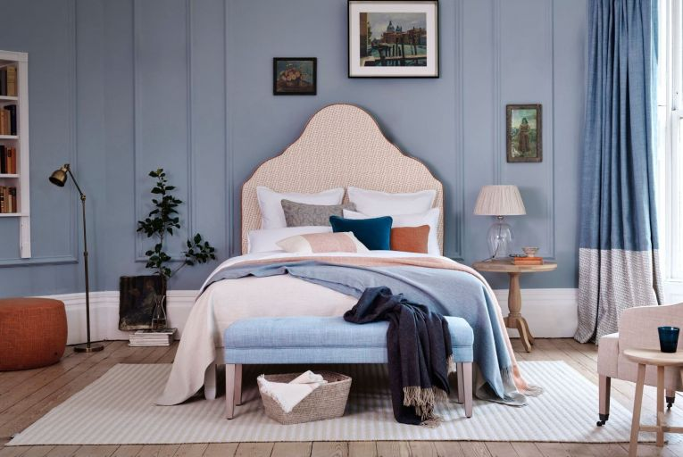 Neptune's colour palette and textures combine the warm with the cool: Clemmie Headboard, King, priced from €705; Chichester Bed Base, priced from €560; Rupert Foot Stool, priced from €470; Chedworth Rug, Off White, priced from €220