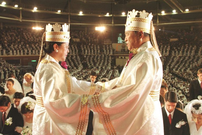 South Korean evangelist Reverend Moon Sun-myung, right, and his wife, founders of the Moonies, bless about 3,500 newlywed couples at South Korea's Olympic stadium in 2002 in Seoul. Picture: Getty