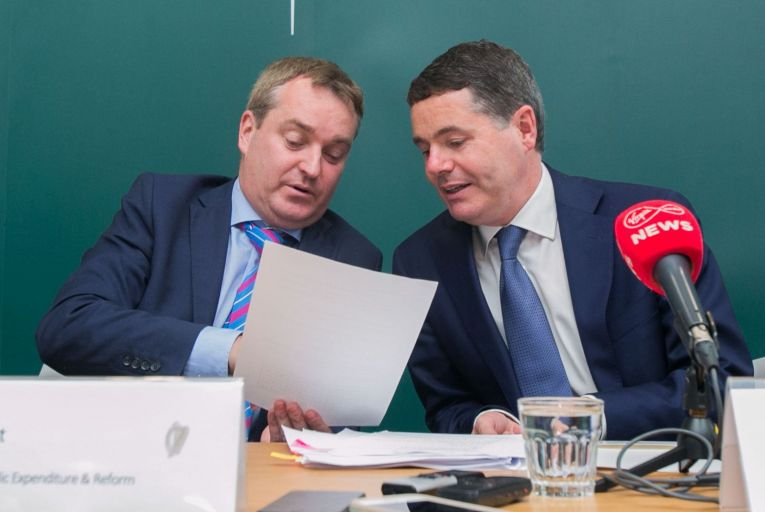 Robert Watt with Paschal Donohoe, the Minister for Finance: he will receive a pay rise of €81,000 when taking up his new job at the Department of Health Picture: Collins