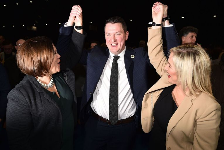 John Finucane of Sinn Féin celebrates his victory in North Belfast with party leader Mary Lou McDonald and deputy leader Michelle O'Neill. Picture: Getty