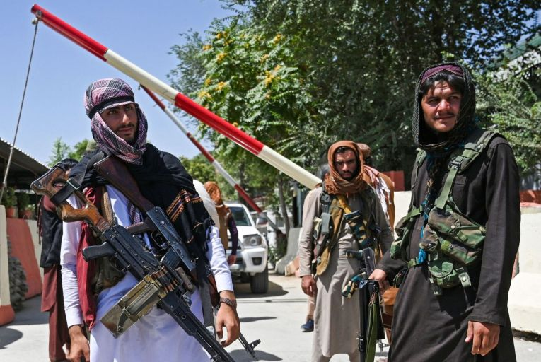 Taliban fighters stand guard along a roadside near Zanbaq Square in Kabul, Afghanistan's capital, earlier this week. Picture: Getty