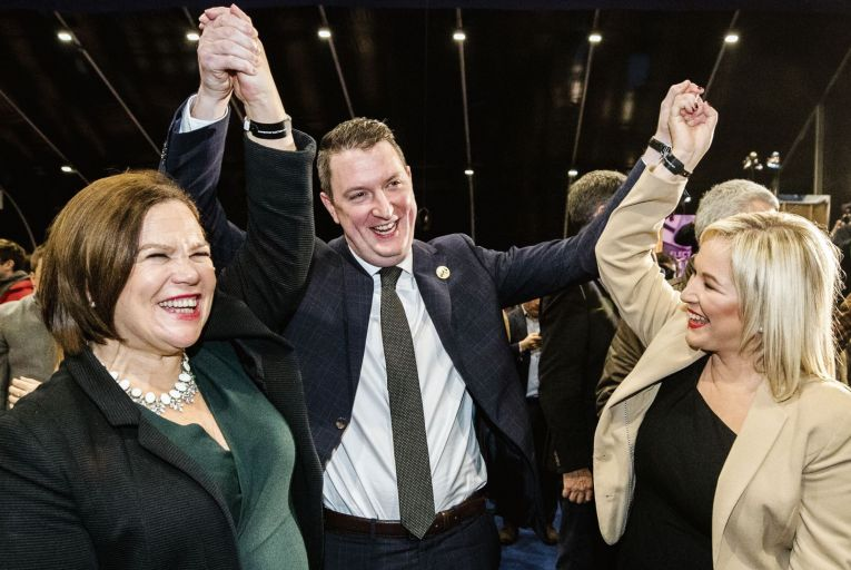 Sinn Féin's newly elected MP for Belfast North John Finucane celebrates with party President Mary Lou McDonald and party vice-president Michelle O'Neill Picture: PA