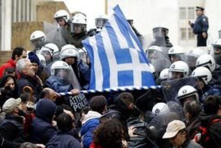 Greeks stage general strike as Samaras heads for Brussels