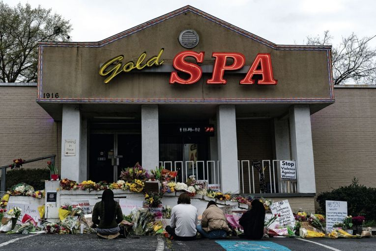 Mourners keeping vigil at the memorial site outside the Gold Spa in Atlanta, Georgia, last week Pic: Getty