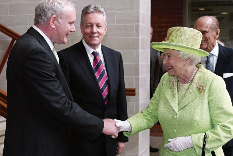 Martin McGuinness and Queen Elizabeth shake hands in 2012, a gesture Al-Shamahi cheekily suggests compares to chimps brushing fingers after a fight. Photo: Getty