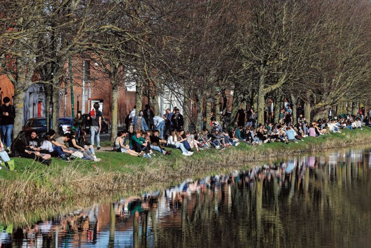 People out in numbers enjoying the sunshine on the Grand Canal in Dublin on St Patrick's Day: it's feared increasing social interactions are keeping Covid numbers high Pic: RollingNews