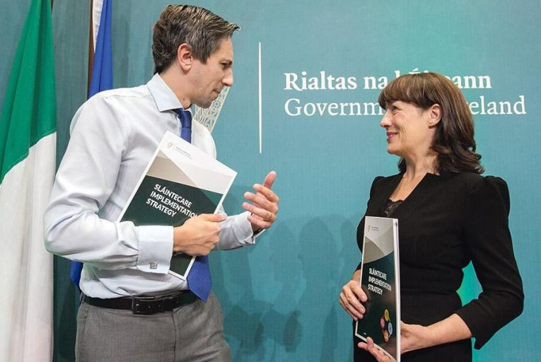 Simon Harris, Minister for Health, and Laura Magahy, executive director of the Sláintecare Programme office at the publication of the Sláintecare strategyPic: Gareth Chaney Collins