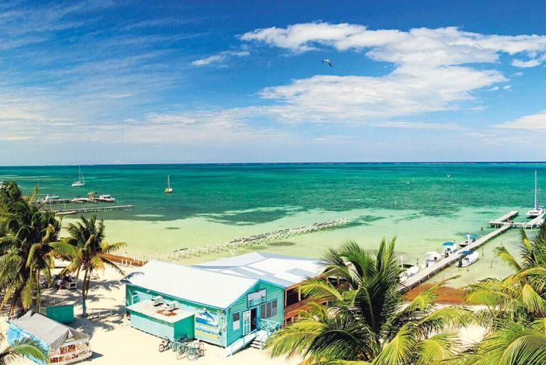 The beautiful aquamarine waters and the reef of Caye Caulker, Belize