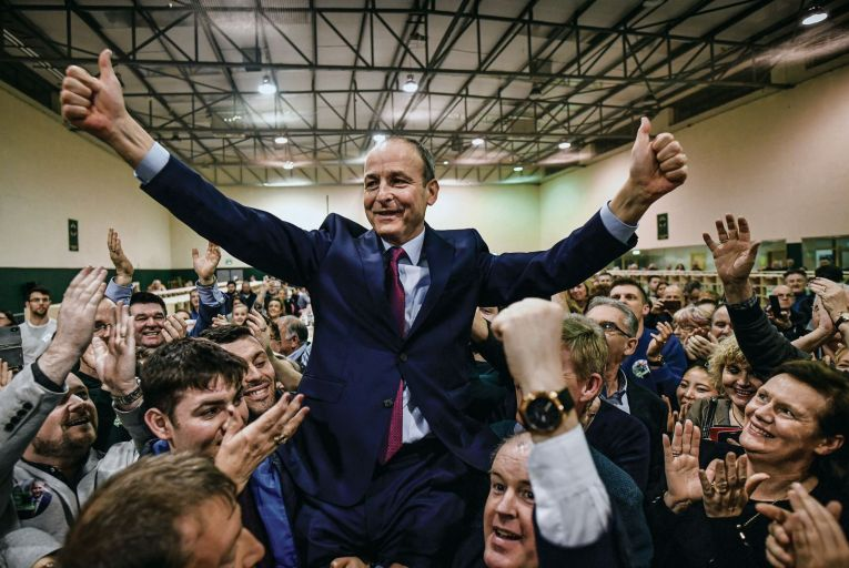 Micheál Martin celebrates being elected to the 33rd Dáil at the Cork South-Central constituency at Nemo Rangers GAA club. Picture: Getty