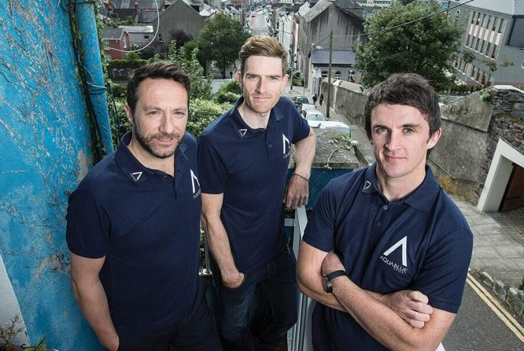 Martyn Irvine, team rider; Tim Barry,  sporting director; and Stephen Barrett, director  of athletic performance  for Aqua Blue Sport  Picture: Cathal Noonan