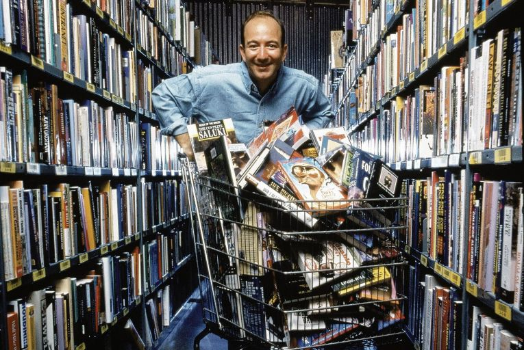Jeff Bezos, chief executive of Amazon, pictured in 1998. In 2018, his worth increased by the annual salary of one of Amazon's entry-level workers every 11.5 seconds