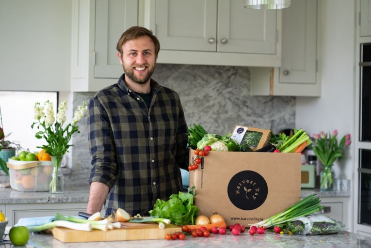 Fergus Halpin, the 28-year-old founder and chief executive of Harvest Day, with one of the company's freshly picked organically and naturally grown 100 per cent Irish boxes. Picture: Marin Bramblett