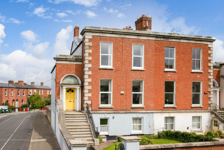 Well maintained, the property retains much of its character with many original features still intact and would easily convert back into a large family residence.  Picture: Mullery O'Gara