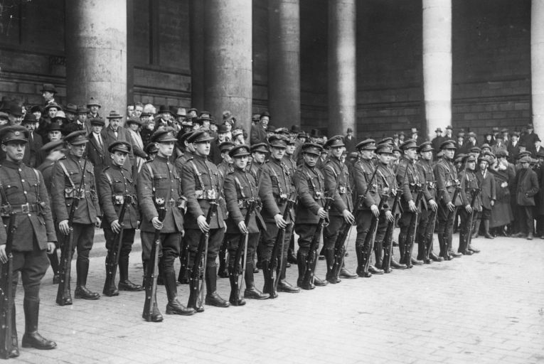 National Army soldiers stand for inspection at the Central Bank of Ireland on Dublin's College Green in March 1922