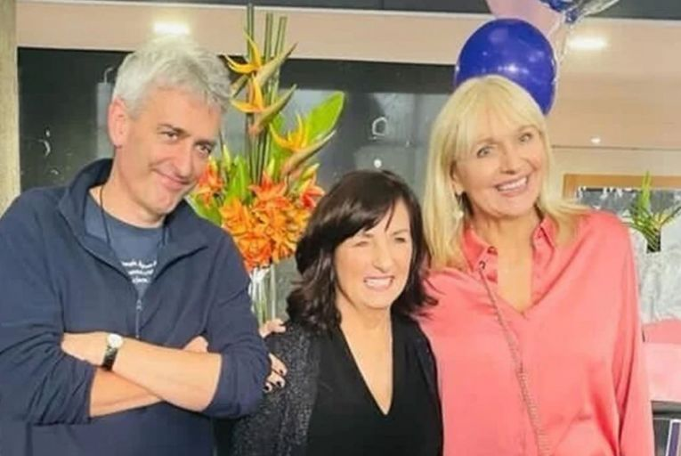 David McCullagh and Miriam O\'Callaghan pose with their colleague on her final day at work